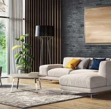 salon moderne avec mur de brique gris